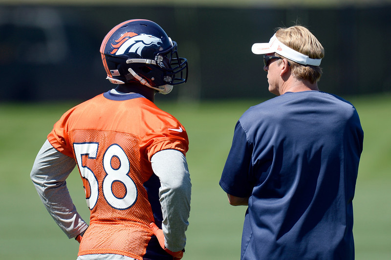 . Von Miller (58) of the Denver Broncos chats with defensive coordinator Jack Del Rio during OTAs June 6, 2013 at Dove Valley. (Photo By John Leyba/The Denver Post)