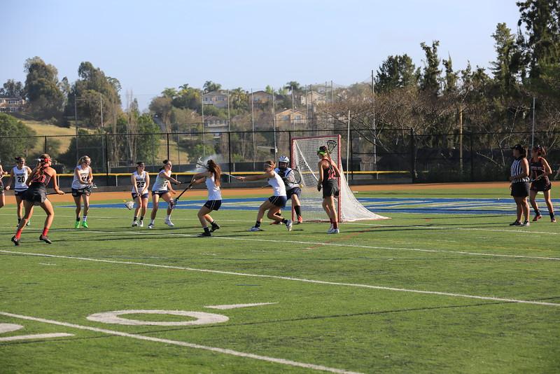 2015_03_31 Girls Lacrosse LCC 15 vs Santa Ana Mater Dei 11 0037.JPG