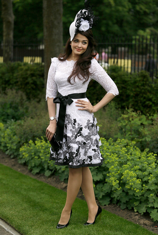 . Bollywood actress Aishwarya Rai Bachchan poses for the media on the first day the Royal Ascot horse race meeting in Ascot, England, Tuesday, June 18, 2013. (AP Photo/Alastair Grant)