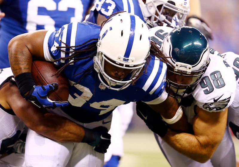 . Running back Trent Richardson #34 of the Indianapolis Colts carries the ball as outside linebacker Connor Barwin #98 of the Philadelphia Eagles makes the tackle during a game at Lucas Oil Stadium on September 15, 2014 in Indianapolis, Indiana.  (Photo by Andy Lyons/Getty Images)