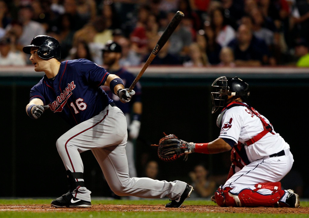 . Minnesota\'s Josh Willingham hits a two-run double during the seventh inning as Indians catcher Carlos Santana looks on.   (Photo by David Maxwell/Getty Images)