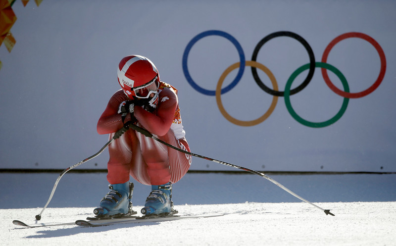 . Switzerland\'s Dominique Gisin crouches in the finish area after a women\'s downhill training run for the 2014 Sochi Winter Olympics, Saturday, Feb. 8, 2014, in Krasnaya Polyana, Russia. (AP Photo/Gero Breloer)