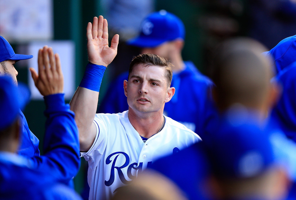 . Johnny Giavotella #9 of the Kansas City Royals is congratulated in the dugout after scoring during the 2nd inning of the game against the Colorado Rockies at Kauffman Stadium on May 13, 2014 in Kansas City, Missouri.  (Photo by Jamie Squire/Getty Images)
