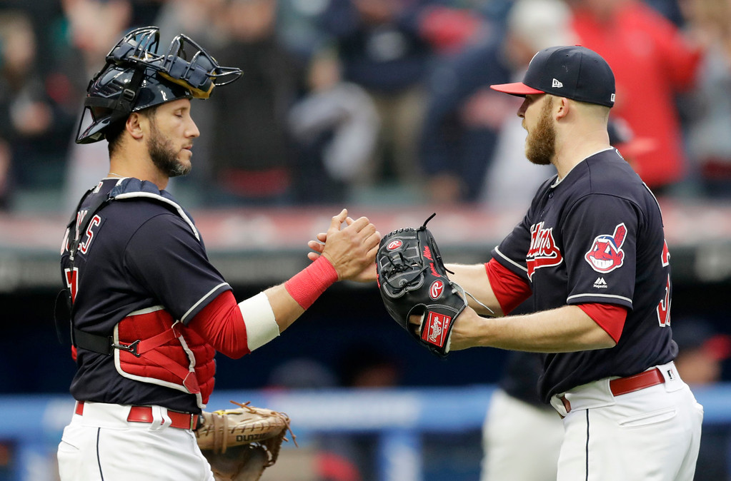 . Cleveland Indians relief pitcher Cody Allen, right, is congratulated by catcher Yan Gomes after the Indians defeated the Kansas City Royals 6-2 in a baseball game, Saturday, May 12, 2018, in Cleveland. (AP Photo/Tony Dejak)