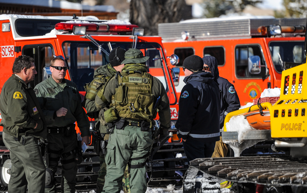 . Authorities regroup in front of their command post near Bear Mountain Resort as the continue the search for fugitive ex-cop Christopher Dorner in Big Bear on Saturday, Feb. 9, 2013. Approximately 50 officers continued the search for Dorner Saturday. (Rachel Luna / Staff Photographer)