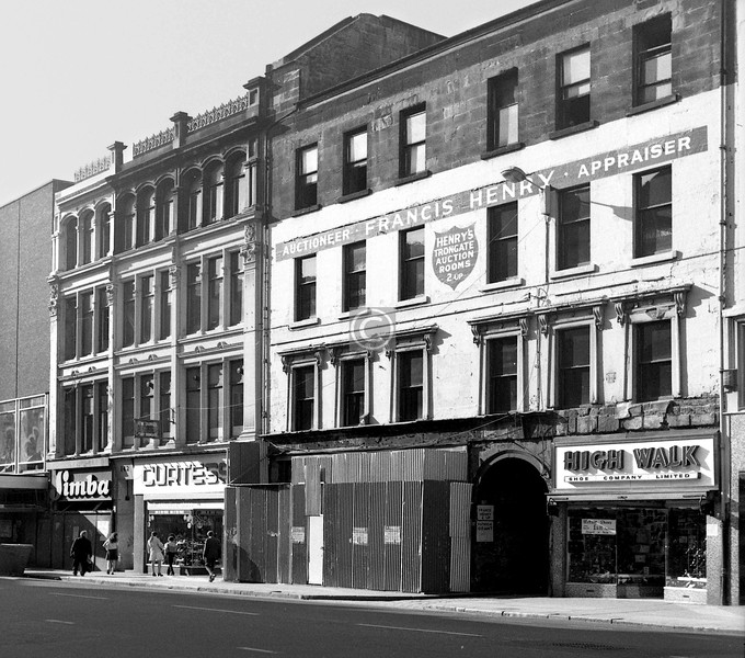 North side of the Trongate, opposite the New Wynd. The further, Italianate building survives, but not the nearer tenement of c1800. 