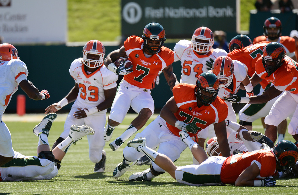. FORT COLLINS, CO - September 28 : Donnell Alexander of Colorado State University (7) gains yards against University of Texas at El Paso defense in the 1st half of the game at Hughes Stadium. Fort Collins, Colorado. September 28, 2013. (Photo by Hyoung Chang/The Denver Post)