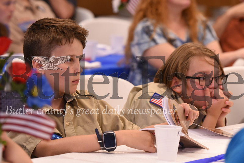 Kaden Crocker, 10, and Ryan Jackson, 11, listen intently to stories from Boy Scout Troop 19 alumni at the troop's 100th anniversary ceremony. Seb Foltz/Butler Eagle