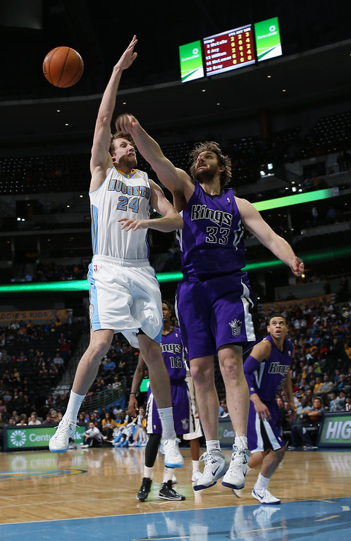 . Sacramento Kings center Aaron Gray, right, blocks shot by Denver Nuggets forward Jan Vesely in the fourth quarter of an NBA basketball game in Denver on Sunday, Feb. 23, 2014. The Kings won 109-95. (AP Photo/David Zalubowski)