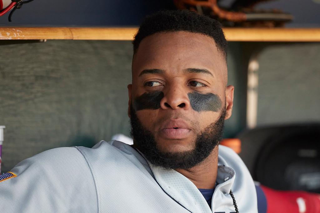 . Cleveland Indians Carlos Santana sits in dugout during the eighth inning of a baseball game against the Detroit Tigers in Detroit, Sunday, July 2, 2017. (AP Photo/Rick Osentoski)