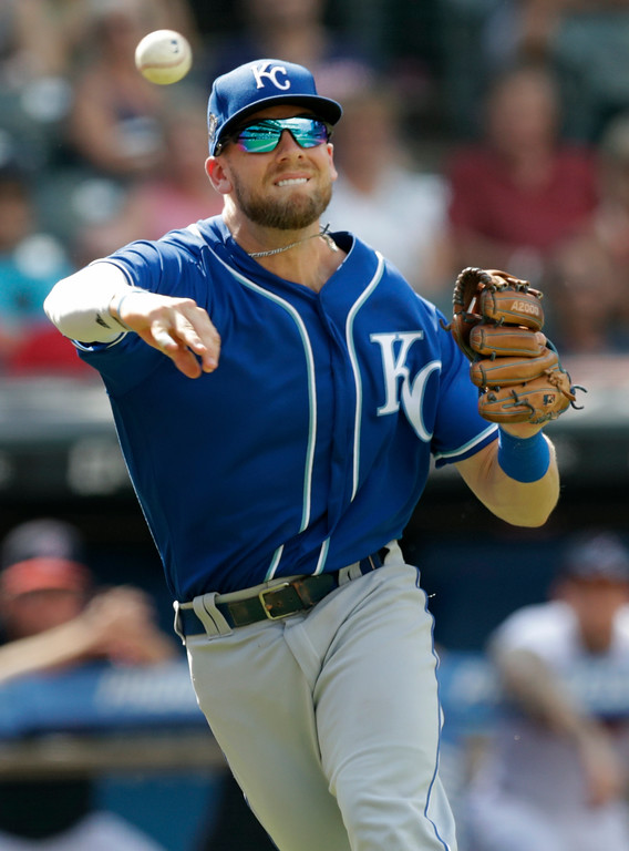 . Kansas City Royals\' Hunter Dozier throws to first base trying to get Cleveland Indians\' Brandon Guyer in the eighth inning of a baseball game, Wednesday, Sept. 5, 2018, in Cleveland. Guyer was safe at second base on a throwing error by Dozier. The Indians won 3-1. (AP Photo/Tony Dejak)