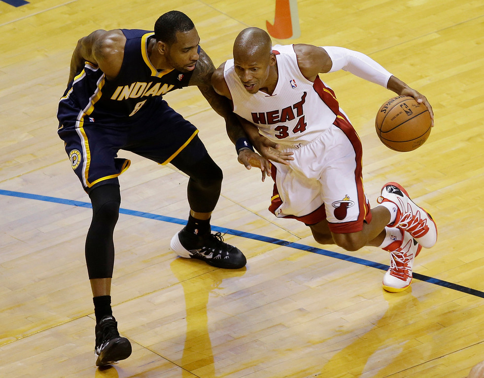 . Indiana Pacers guard Rasual Butler (8) defends Miami Heat guard Ray Allen (34), during the first half of Game 4 in the NBA basketball Eastern Conference finals playoff series, Monday, May 26, 2014, in Miami. (AP Photo/Lynne Sladky)