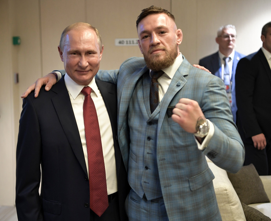 . Russian President Vladimir Putin, left, and Ultimate fighting star Conor McGregor pose for a photo during the final match between France and Croatia at the 2018 soccer World Cup in the Luzhniki Stadium in Moscow, Russia, Sunday, July 15, 2018. (Alexei Nikolsky, Sputnik, Kremlin Pool Photo via AP)