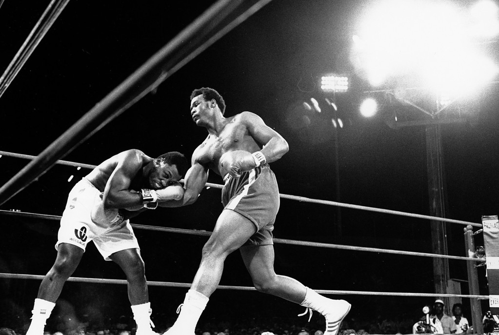 . George Foreman slides a right past champion Joe Frazier\'s chin in the first round of the title fight in Kingston, Jamaica on Jan. 22, 1973.  Foreman won the World Heavyweight Championship title bout in the second round after the referee stopped the fight.  (AP Photo)