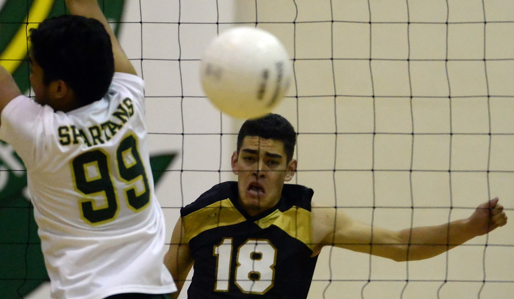 . Santa Fe\'s Josue Chavez (18) returns a shot against Damien\'s Christian Hernandez (99) in the first game of a prep volleyball match at Damien High School in La Verne, Calif., on Wednesday, May 20, 2015. Damien won 25-17, 25-19, 29-27. (Photo by Keith Birmingham/ Pasadena Star-News)