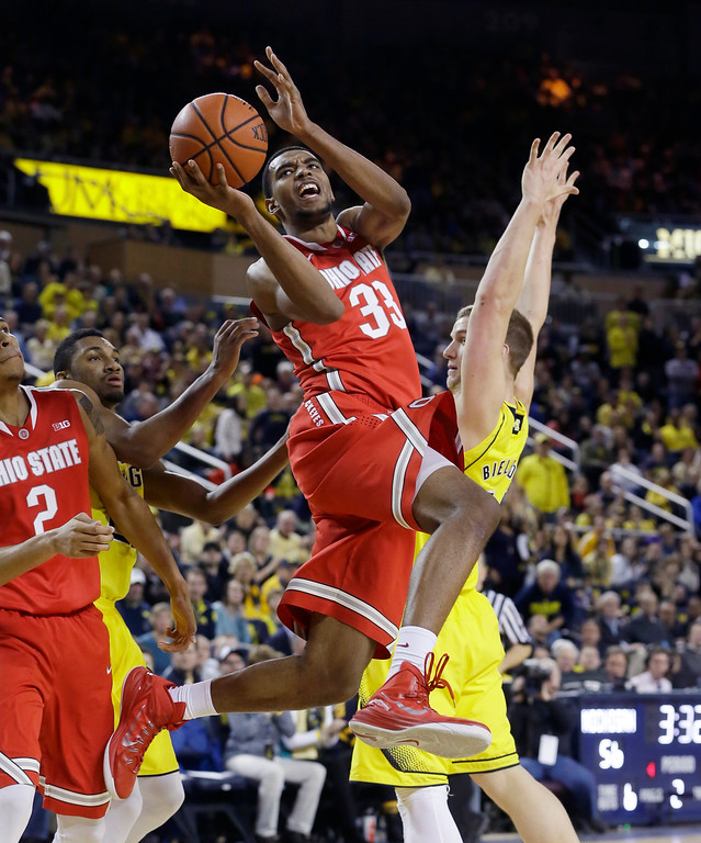. Ohio State forward Keita Bates-Diop makes a layup during the second half of an NCAA college basketball game against Michigan, Sunday, Feb. 22, 2015, in Ann Arbor, Mich. Michigan defeated Ohio State 64-57. (AP Photo/Carlos Osorio)