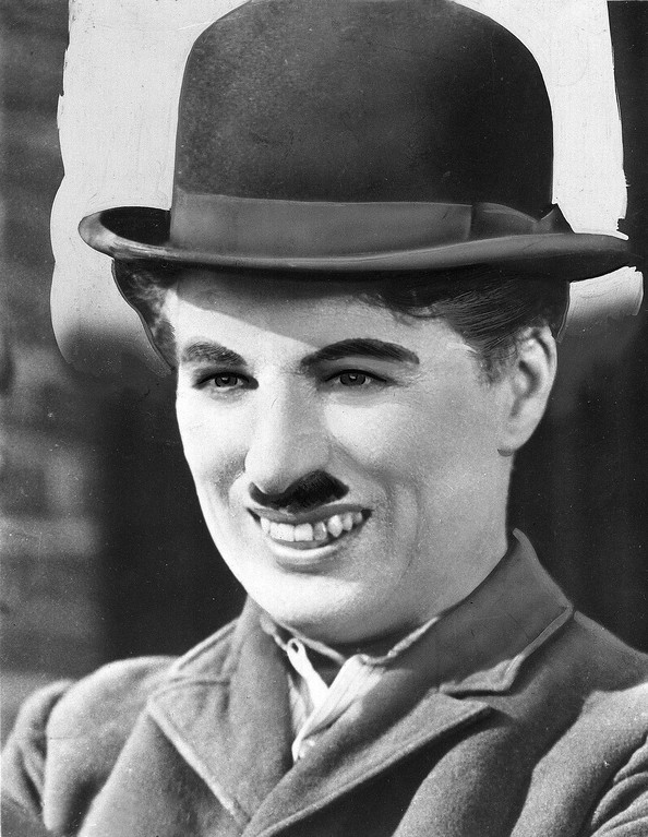 """. ** FILE ** This is an undated photograph of silent movie star Charlie Chaplin. A bamboo cane that Chaplin used in the classic 1930s spoof \""""Modern Times\"""" sold for $91,800 at a sale of movie memorabilia. (AP Photo/File)"""
