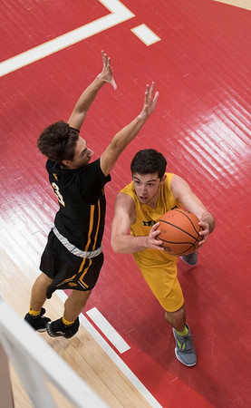 DAVID LIPNOWSKI / WINNIPEG FREE PRESS   John Taylor Collegiate pipers Ricky Zimbakov (#10) during game against the Fort Richmond Centurions as part of the annual Wesmen Classic Tuesday December 25, 2016 at the Duckworth Centre.