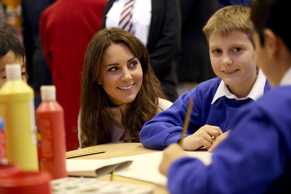 . Britain\'s Kate, Duchess of Cambridge meets children working on projects as she visits Manor School during an official visit to Cambridge, England on Wednesday Nov. 28, 2012 .  (AP Photo/Chris Jackson)