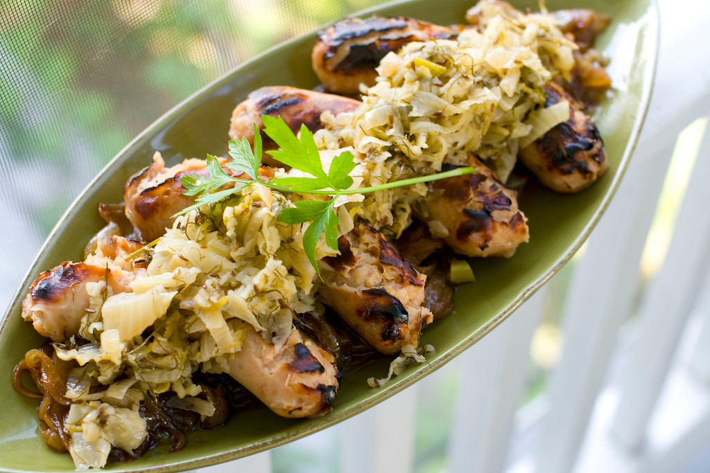 ". Hard cider-soaked apple-sage sausages with apple-fennel sauerkraut. <a href=""http://www.stltoday.com/lifestyles/food-and-cooking/for-tastiest-sausage-grill-then-simmer/article_5febab33-6a02-51f5-b389-0812af326e58.html\"">This recipe is perfect for a tailgate, a Halloween party, a football Sunday or an Oktoberfest</a>.  (AP Photo/Matthew Mead)"