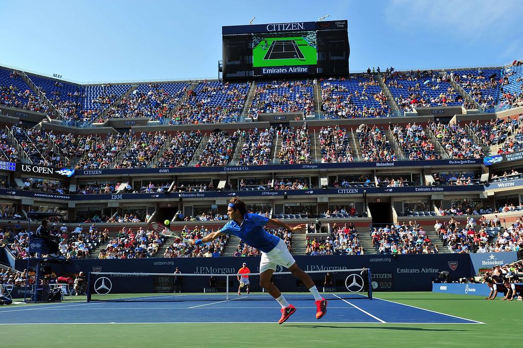 . Roger Federer of Switzerland returns a shot to Grega Zemlja of Slovenia during their 2013 US Open men\'s singles match at the USTA Billie Jean King National Tennis Center August 27, 2013 in New York. STAN HONDA/AFP/Getty Images