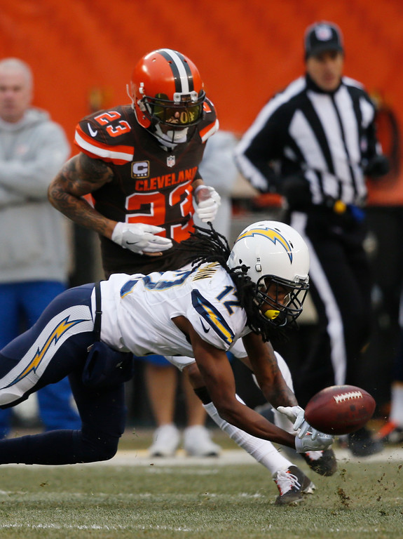 . Cleveland Browns cornerback Joe Haden (23) breaks up a pass intended for San Diego Chargers wide receiver Travis Benjamin (12) in the first half of an NFL football game, Saturday, Dec. 24, 2016, in Cleveland. (AP Photo/Ron Schwane)