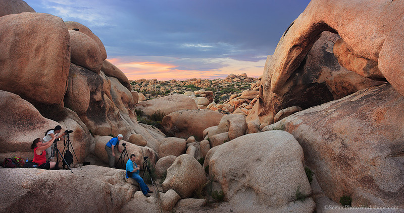 Joshua Tree photo workshop in action!!  Shooting the natural arch formation in the land full of surreal Dr. Sues trees.  Light painted after the wild summer monsoon clouds slowly faded into the night sky.