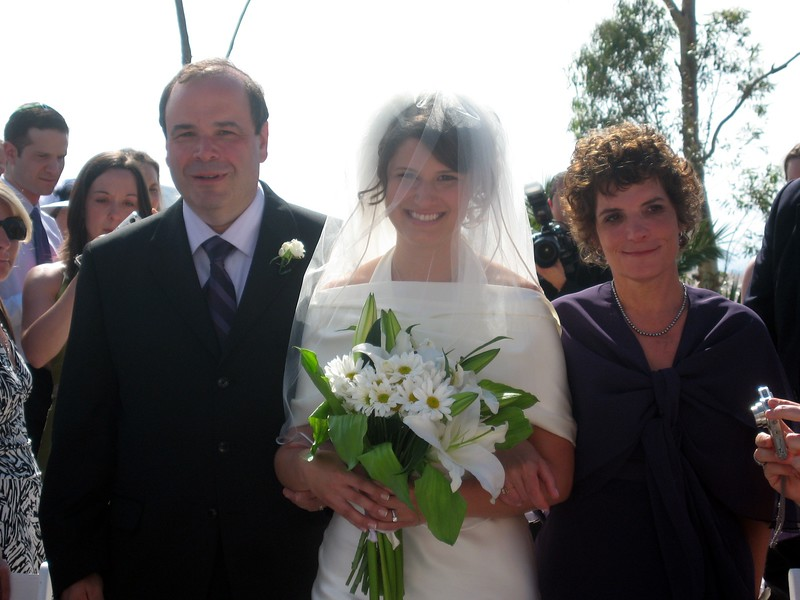 Gary and Hope (parents of the bride) escort Abby