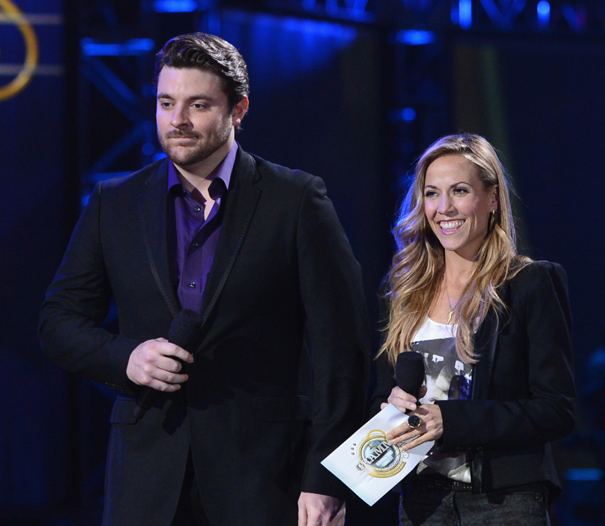 . Sheryl Crow and Chris Young attend The GRAMMY Nominations Concert Live!! held at Bridgestone Arena on December 5, 2012 in Nashville, Tennessee.  (Photo by Kevin Winter/Getty Images)