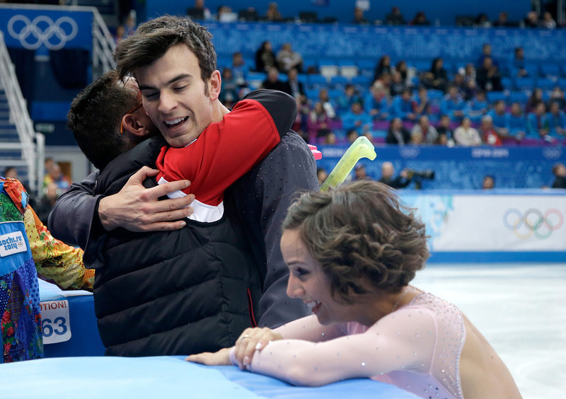 . Meagan Duhamel and Eric Radford of Canada hug coach Richard Gauthier (L) after competing in the Figure Skating Pairs Short Program during the Sochi 2014 Winter Olympics at Iceberg Skating Palace on February 6, 2014 in Sochi, Russia.  (Photo by Darren Cummings/Pool/Getty Images)