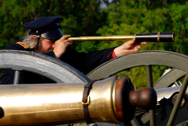 Bob Wolf uses a long spyglass to view Ft. Sumter from his artillery battery at Patriots Point in Mt. Pleasant, South Carolina on Sunday, April 10, 2011. ..The 150th Anniversary of the Firing on Ft. Sumter was commemorated with lectures, performances, demonstrations, and a living history throughout the area on James Island, Charleston, Mt. Pleasant, and Sullivan's Island during the week from April 8-14, 2011. Photo Copyright 2011 Jason Barnette