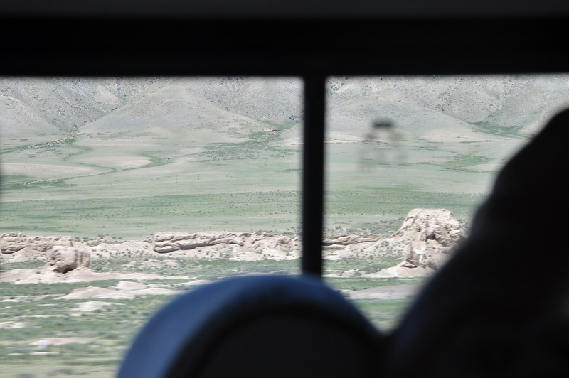 As we neared Jiayuguan, we began to see these remnants of the original Great Wall, which have weathered down to nearly nothing here.  Unfortunately, they were on the wrong side of the bus for me to take good pictures...!