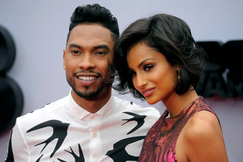 Description of . Miguel Jontel Pimentel, left, and Nazanin Mandi arrive at the BET Awards at the Nokia Theatre on Sunday, June 30, 2013, in Los Angeles. (Photo by Chris Pizzello/Invision/AP)