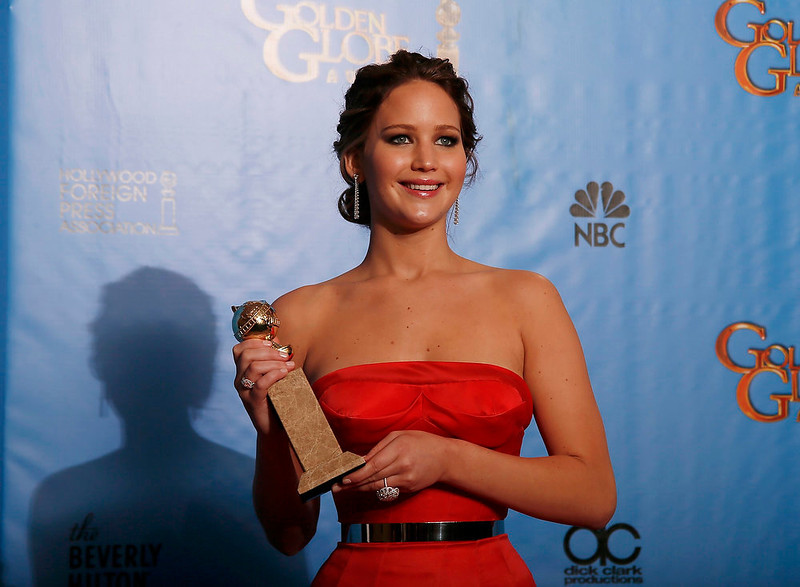 ". Jennifer Lawrence holds the award she won for Best Actress in a Motion Picture, Comedy or Musical for her work in ""Silver Linings Playbook\"" backstage at the 70th annual Golden Globe Awards in Beverly Hills, California, January 13, 2013.  REUTERS/Lucy Nicholson"