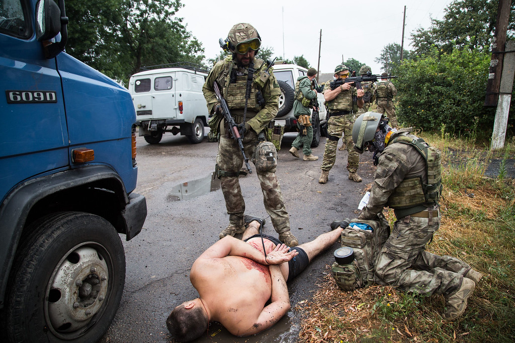 . Armed Ukrainian forces detain a pro-Russian militant in the village of Chornukhine in the Lugansk region on August 18, 2014.  AFP PHOTO/ OLEKSANDR  RATUSHNIAK/AFP/Getty Images