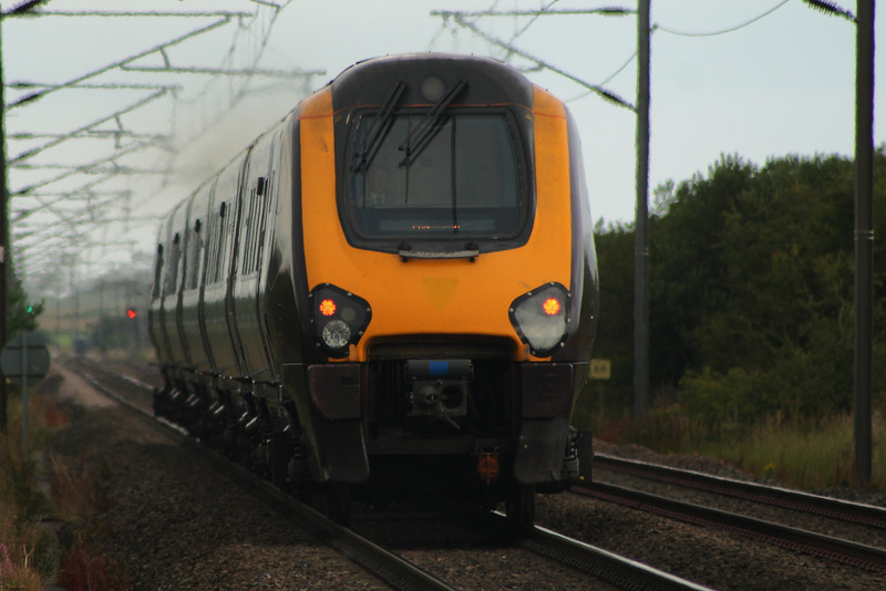 221130 on a Northbound CrossCountry service passing West Goswick Farm LC