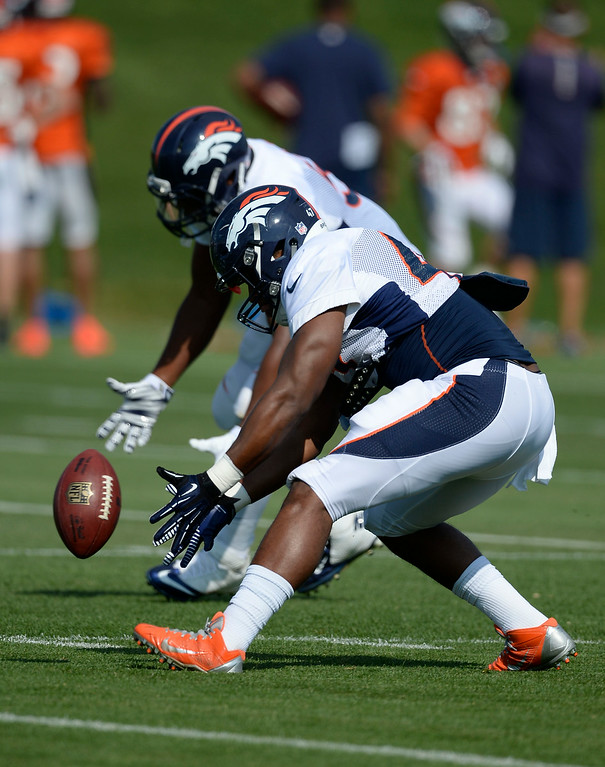 . Denver Broncos outside linebacker Corey Nelson (47) picks up a loose ball during drills on day five of the Denver Broncos 2014 training camp July 28, 2014 at Dove Valley. (Photo by John Leyba/The Denver Post)