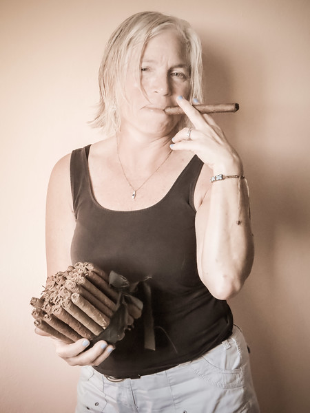 Jennifer shows off the group's stash of hand-rolled cigars on International Day of Women March8.