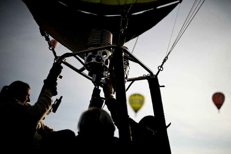 . Passengers and pilots of a hot air balloon stand inside the basket for take off during the 18th International Festival of Hot Air Balloons in Alter do Chao in the center of Portugal on November 10 2014. PATRICIA DE MELO MOREIRA/AFP/Getty Images
