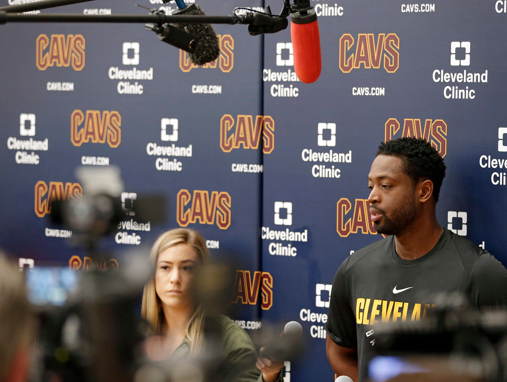 . Cleveland Cavaliers\' Dwyane Wade answers questions during a news conference at the NBA basketball team\'s training facility, Friday, Sept. 29, 2017, in Independence, Ohio. Wade once convinced LeBron James that Miami was the place to be. Seven years later, James lured Wade to Ohio for the chance to win another NBA title, together.(AP Photo/Tony Dejak)