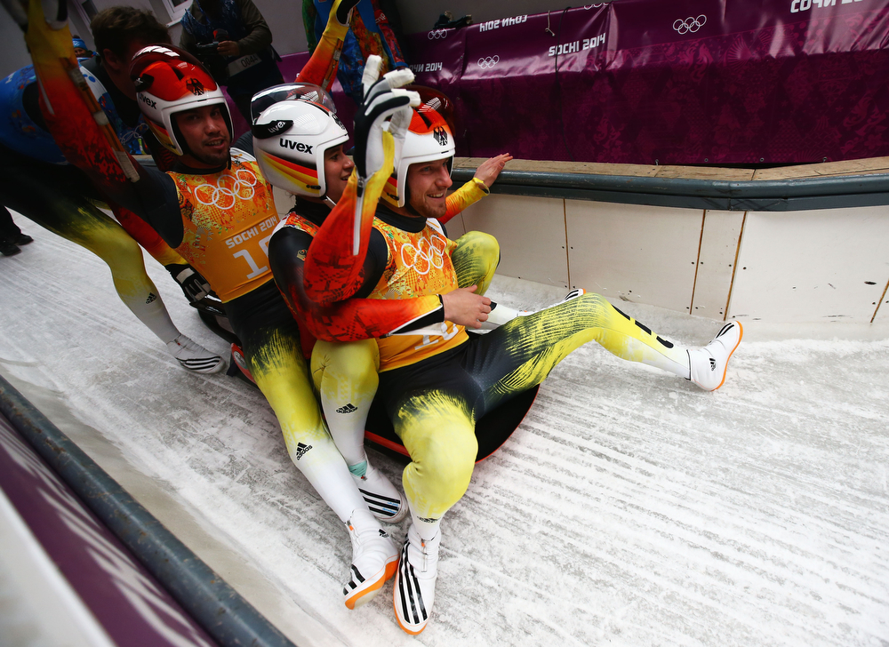 . (L-R) Tobias Wendl, Natalie Geisenberger and Tobias Arlt of Germany react after a run during the Luge Relay on Day 6 of the Sochi 2014 Winter Olympics at Sliding Center Sanki on February 13, 2014 in Sochi, Russia.  (Photo by Doug Pensinger/Getty Images)