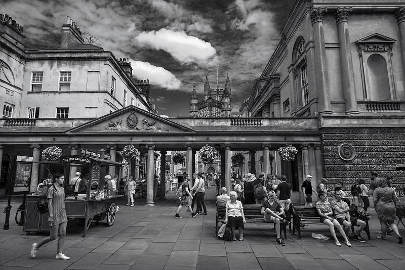 People enjoying the summer in the town center.  Bath, England, 2018