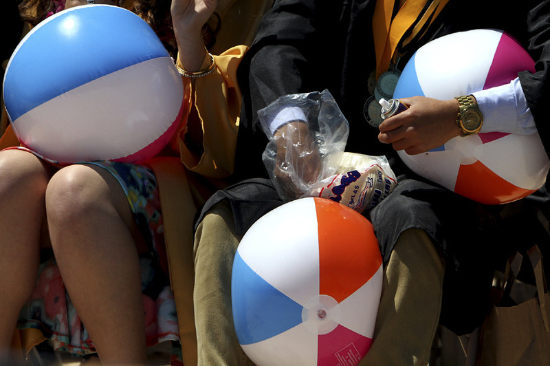 . Watsonville High graduates ready beach balls, Silly String and tortillas for tossing into the air during the 2013 graduation ceremony. (Kevin Johnson/Sentinel)