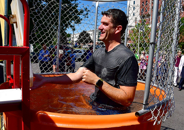 8/29/2019 Mike Orazzi | Staff Dr. Kevin Gentile while in the dunk tank during the Bristol Hospital Foundation's Food Truck Festival to raise funds for the emergency center renovation and expansion project on Thursday.