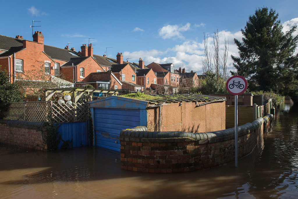 . A flooded cycle path off Pitchcroft Lane is seen on February 13, 2014 in Worcester, Worcestershire, England. The Environment Agency has issued flood warnings for dozens of areas along the River Severn. (Photo by Rob Stothard/Getty Images)