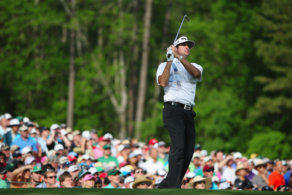 . Bubba Watson of the United States watches his tee shot on the 12th hole during the final round of the 2014 Masters Tournament at Augusta National Golf Club on April 13, 2014 in Augusta, Georgia.  (Photo by Andrew Redington/Getty Images)