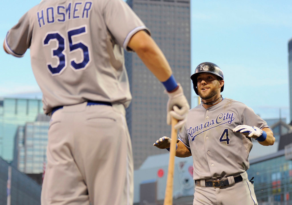 . Eric Hosmer #35 of the Kansas City Royals congratulates teammate Alex Gordon #4 on a solo home run against the Minnesota Twins during the third inning. (Photo by Hannah Foslien/Getty Images)
