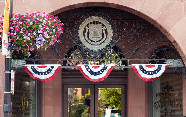 06/29/18 Wesley Bunnell | Staff Red, white and blue bunting decorates New Britain City Hall on Friday afternoon in preparation of the upcoming July 4 holiday.
