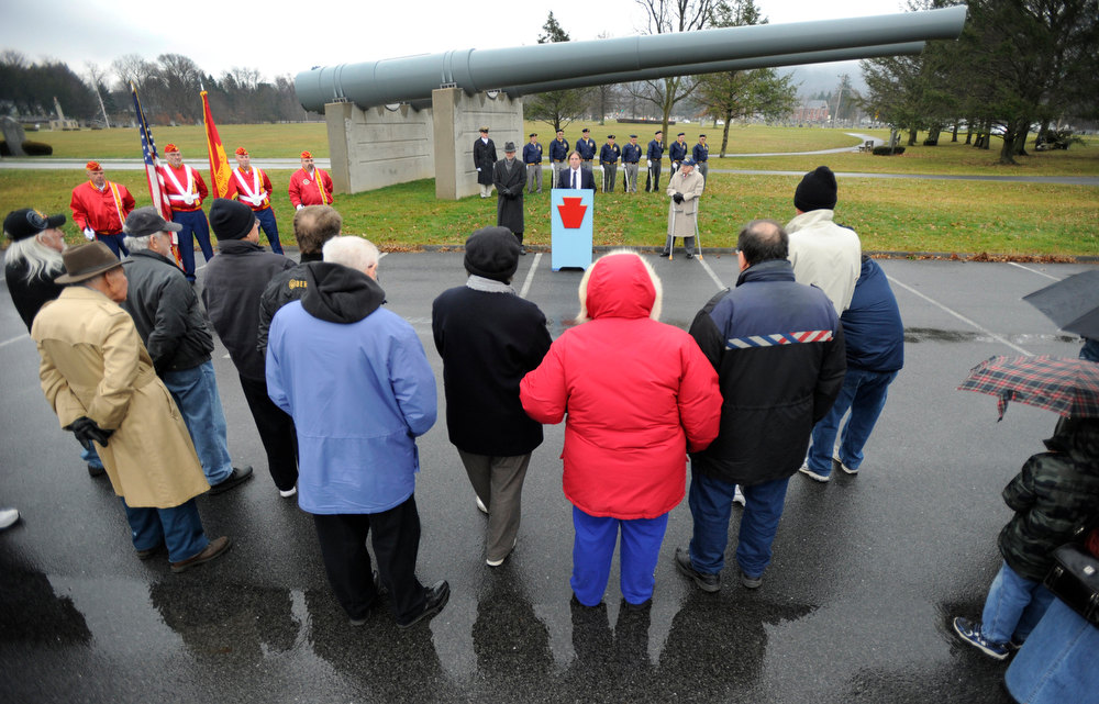 Description of . Jim Bloom, a retired US Navy Captain, gives the keynote address during a Pearl Harbor Remembrance Day and ceremony at the Pennsylvania Military Museum, in Boalsburg, Pa., Friday, Dec. 7, 2012 is   (AP Photo/Centre Daily Times, Centre Daily Times)