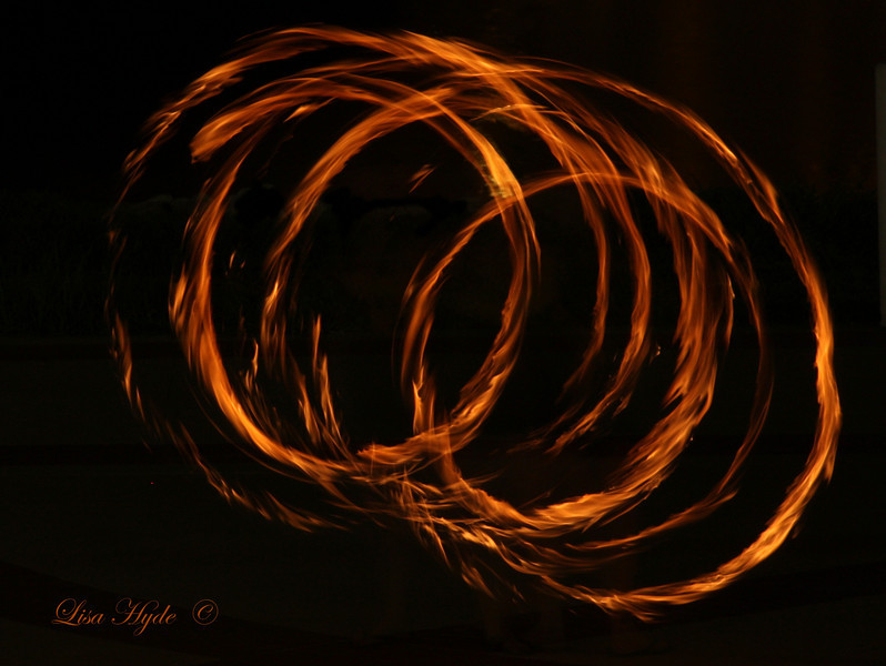 "Little Rock Fire and Poi is a group of entertainers who artistically perform with fire or LED hoops, staffs, and balls on chains.  Poi, is New Zealand's Maori word for ""ball"" on a chain."